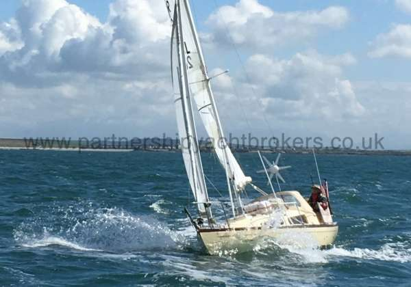 Folkboat Cruising Yacht In a seaway - owners pic