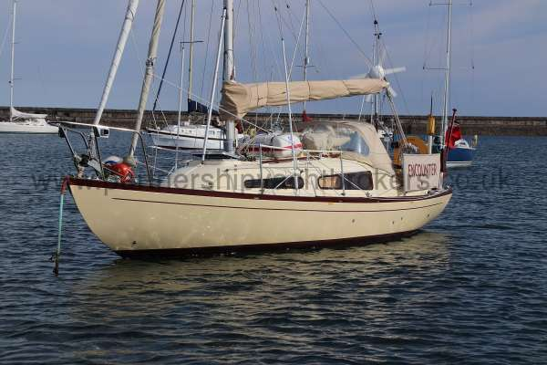 Folkboat Cruising Yacht Port side view -