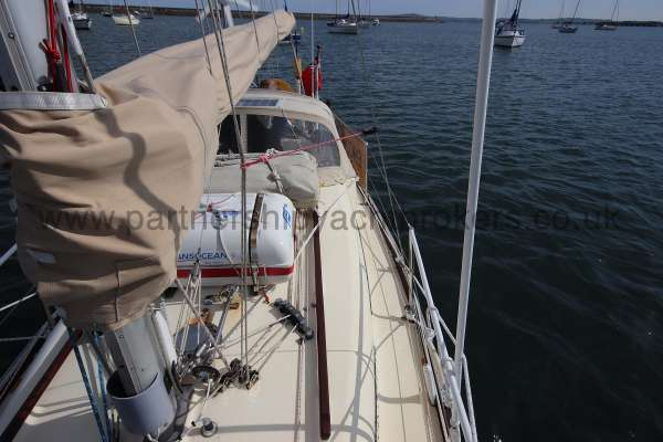 Folkboat Cruising Yacht Port side deck view - sail cover and lazy jacks