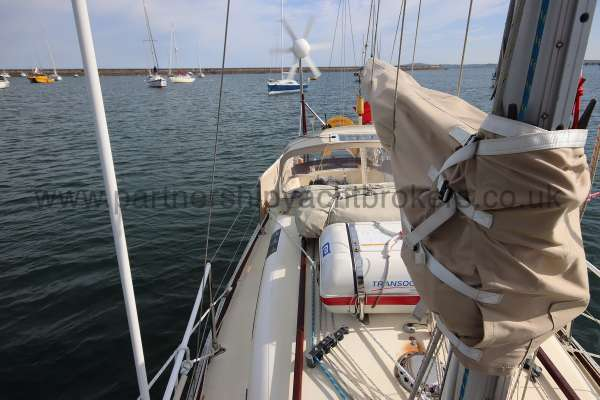 Folkboat Cruising Yacht Starboard side deck view - sail cover and lazy jacks