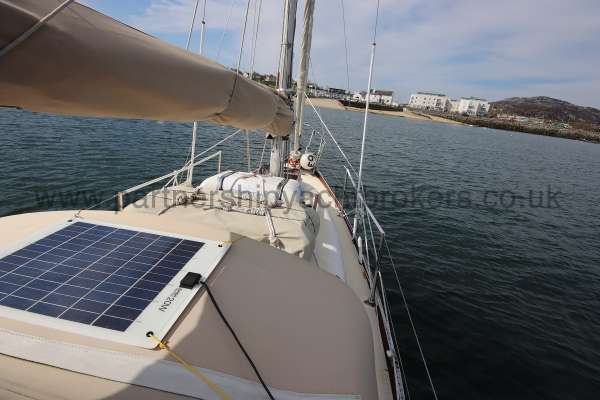 Folkboat Cruising Yacht Deck view - note the solar panel