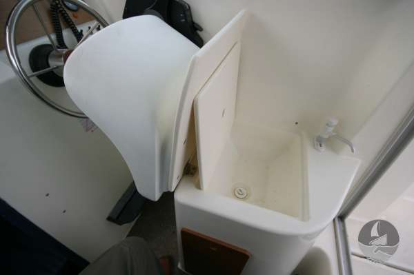 Jeanneau Merry Fisher 585 Seat tipped to reveal the sink -