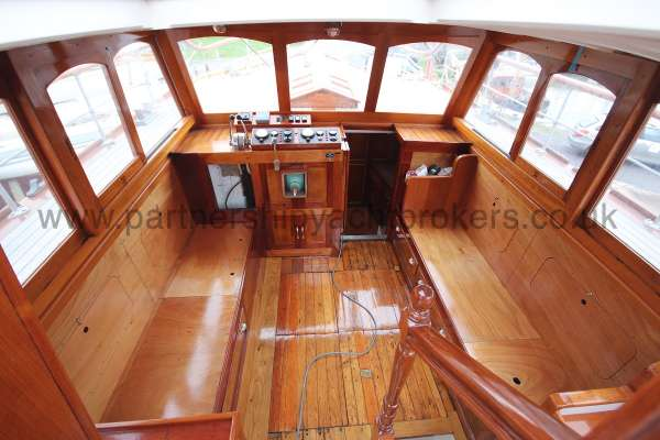 Wooden Classic Motor Yacht Twin Engine Looking into the wheelhouse -