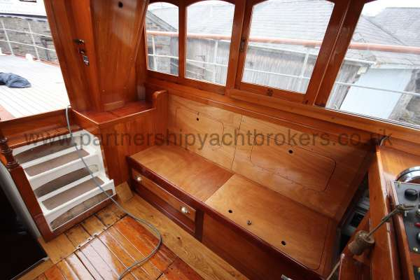 Wooden Classic Motor Yacht Twin Engine Wheelhouse view - gleaming bright work