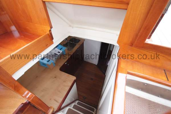 Wooden Classic Motor Yacht Twin Engine Looking into the galley - from the wheelhouse