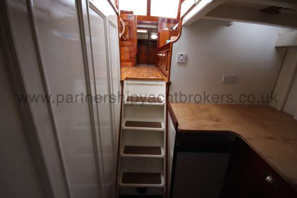 Wooden Classic Motor Yacht Twin Engine Steps to the wheelhouse - from the galley