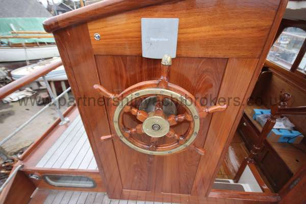 Wooden Classic Motor Yacht Twin Engine The helm  - duplicated in wheelhouse