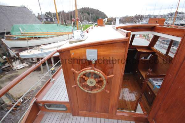 Wooden Classic Motor Yacht Twin Engine The outer helm position - with wheel in place