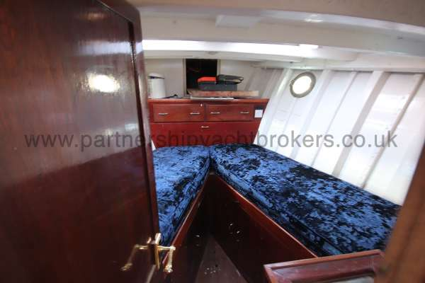 Wooden Classic Motor Yacht Twin Engine The fore cabin - two berths