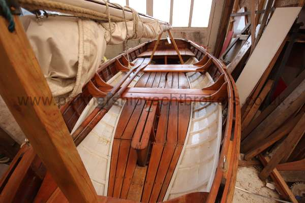 Wooden Classic Clinker built sailing dinghy Wooden clinker dinghy  - interior view note the centre board case