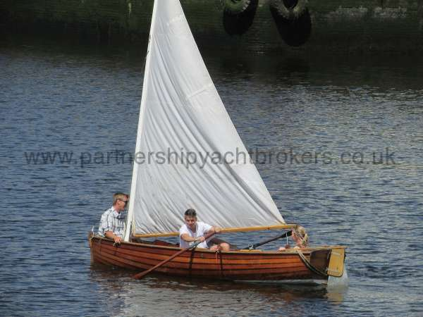 Wooden Classic Clinker built sailing dinghy Wooden clinker dinghy  - afloat under sail