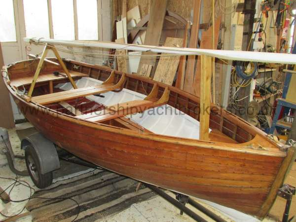 Wooden Classic Clinker built sailing dinghy Wooden clinker dinghy  - starboard side view