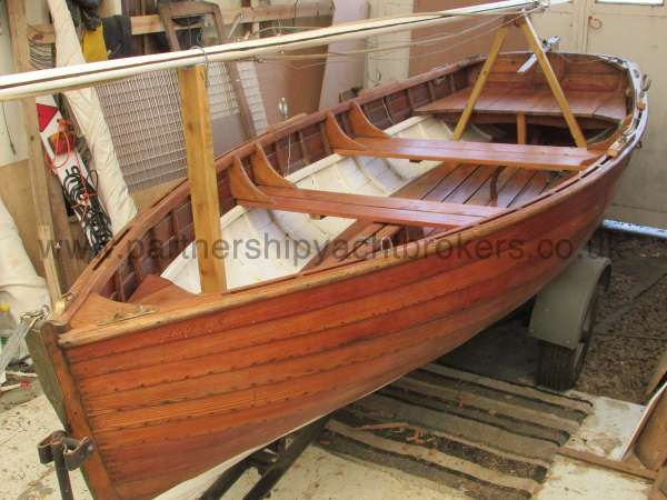 Wooden Classic Clinker built sailing dinghy Wooden clinker dinghy  - port side view