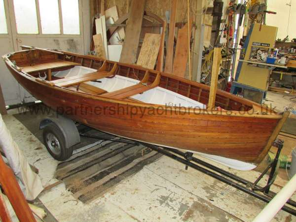 Wooden Classic Clinker built sailing dinghy Wooden clinker dinghy  - on her road trailer