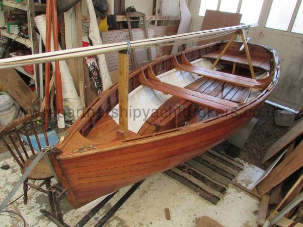 Wooden Classic Clinker built sailing dinghy Wooden clinker dinghy  - with the mast stowed