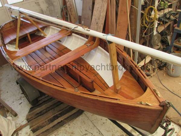 Wooden Classic Clinker built sailing dinghy Wooden clinker dinghy  - mast stowed for transport
