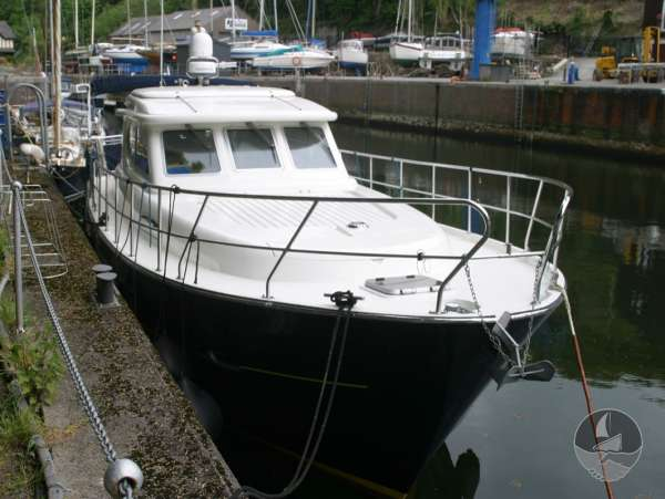 Elling E3 Executive Specification Alongside her marina berth -
