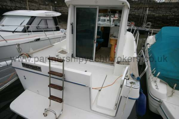 Beneteau Antares 760 Stern view - with boarding platform and ladder