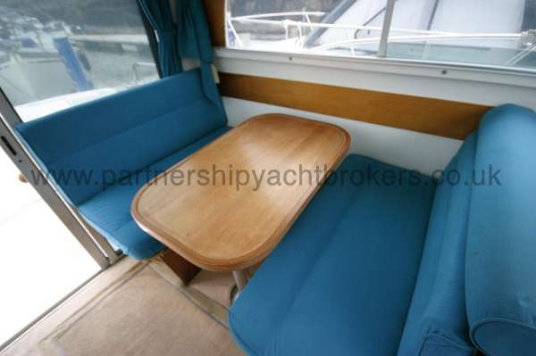 Beneteau Antares 760 The wheelhouse table - Converts to a double berth