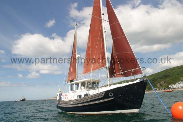 Fisher 25 Close up with sails hoisted -