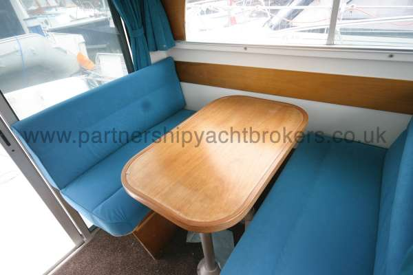 Beneteau Antares 760 The dinette - This converts to a double berth