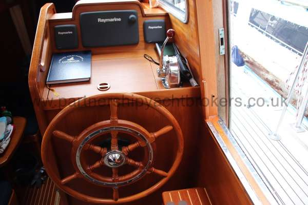 Nauticat 331 The inside helm position - Located to starboard in the deck saloon